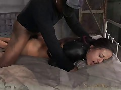 Latina bed bound in leather straightjacket