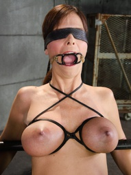 Blindfolded MILF restrained