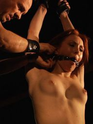Submissive sub girl, wearing ball-gag and immobilized, is intensely whipped in a bdsm fetish game...