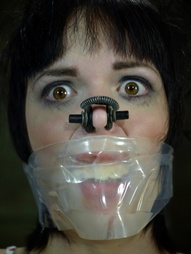 Gagged, blindfolded, with her hands tied behind her back, Madisin Moon waits for PD to come punish..