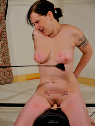 With hands tied above her head, Beatrix is forced to thrust her tits out for the whips and..