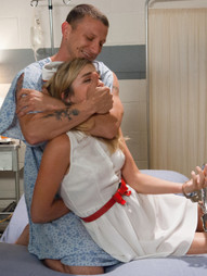 Nurse Lia Lor is caring for a man who was injured during his arrest and is now detained to a..