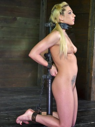 Bailey Blue is bound in a position that gives new meaning to 'face down; ass up'. Her exposed..