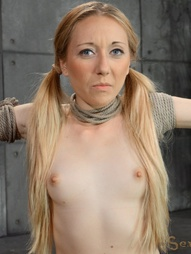 Little blonde bound in metal bondage